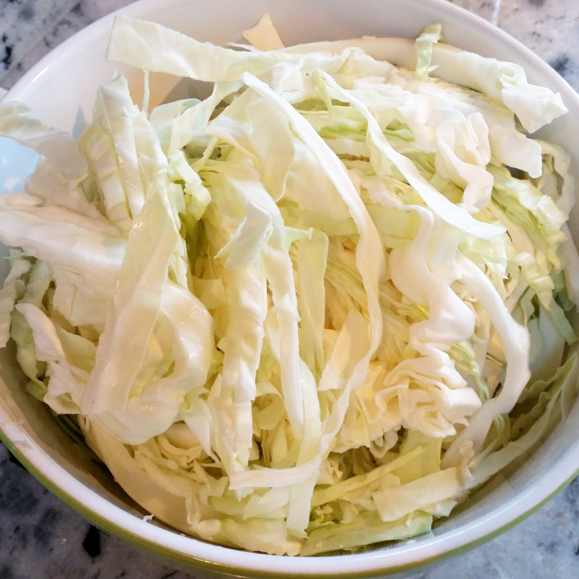 Slice the cabbage and put in a bowl
