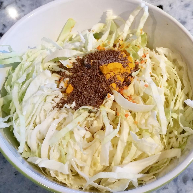 Add turmeric, seeds and salt